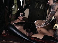 These hot lesbians know how to have fun. Without wasting time, they undress and put on latex rabbit masks, so sexy! Now it's time to relax... Horny babes are licking each others juicy pussies, moaning from pleasure. Hot lesbian foursome! Enjoy!