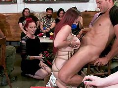 In a crowded bar, in front of all visitors, the busty redhead milf Bella Rossi was bound and fucked. She sucked the dick of a stranger guy and then gave him a titjob. Relax and enjoy impetuous sex action in public!
