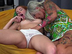 This experienced lesbian knows how to act to find a new lover. She found for herself Xandra, modest red-haired girl and immediately dragged her into bed, to taste her wet cunt. Watch sensual pussy licking and enjoy!