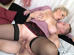 Her huge saggy tits were shaking to the beat with his sharp jolts and with every stroke, the blonde mature was moaning loudly. Pull your cock out of your pants and enjoy this impetuous sex action! Hot stuff!