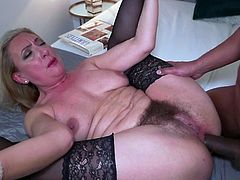 Unfortunately Elizabeth's black lover was not in the delight of her hairy pussy and so, without a second thought, he quickly inserts his huge black penis into her tight asshole. At first the busty mature screamed in pain and surprise, but then began to enjoy... Have fun!