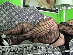 Thick thighs in fishnets open for masturbation