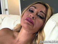 Claudia Valentine strips and plays with her pussy