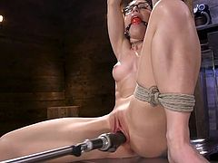 She is all gagged up and ready to be fucked. This nerdy and sexy babe doesn't need a man because she is happy being railed hard by a mechanical fuck machine. Being in bondage makes her so horny. She gets wetter as the dildo is rammed in her pussy.