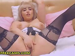 This gorgeous chubby blonde chick with angel face is ready to strip sexy and slowly making your cocks rock hard.First she exposed her big natural tits touching and squeezing them really sexy and tempting after she striped her panties and started fingering her tight wet saved pussy.She continued fingering her pussy spreading her chubby legs and teasing with her sexy black stockings.