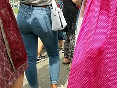 This hot teen is walking around the street in this amazing tight jeans showing her perfect round booty in candid footage