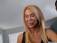 Check out this smoking hot and horny blonde mature fuck slut getting her pussy drilled hard by a bunch of big black cocks.Watch in HD.