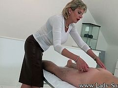 Lady Sonia is not only great at giving massages but shes even better with handjobs! She rubs his back then begins jerking off his long cock!