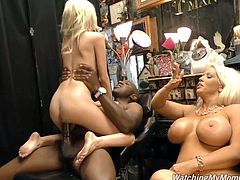 Check out these smoking hot and horny blonde busty fuck sluts getting their wet pussies drilled hard by a black monster cock.Watch in HD.