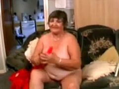 Libby enjoys masturbating herself with a large red dildo