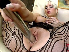 Lusty blonde babe Cindy Dollar shows you her fantastic horny body in her designer pantyhose & starts playing with a vibrator! The hot girl also shows her firm tits off for your pleasure... Enjoy her cock-hardening solo!