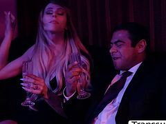 Busty blonde shemale is in the champagne room with a guy.After they drink,they start kissing each other and she then throat guys big cock passionately.In return the guy licks her ass first to makes it wet before fucking it so hard.